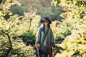 Boho style woman in the forest