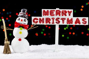 Snowman with a Merry Christmas signpost
