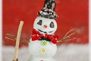 Snowman on red background