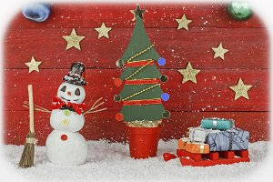 Snowman with sleigh and Christmas tree