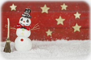 One snowman on red background