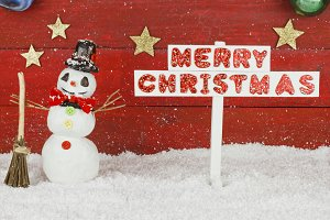One snowman and a signpost with the words Merry Christmas