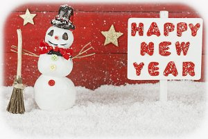 One snowman and a signpost with the words Happy New Year