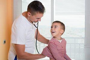 Doctor examines child