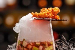 Fruit soup with shrimp popcorns