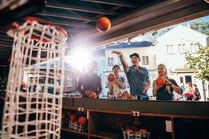 Group of friends shooting hoops