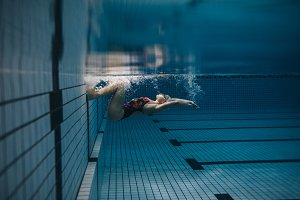 Female swimmer in action