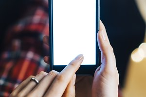 Female hands using smart phone