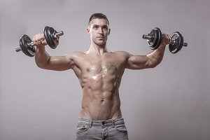 bodybuilder dumbbells posing