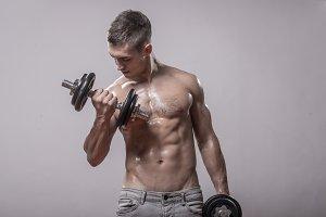 bodybuilder dumbbells exercise man