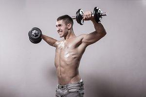 pain exercise dumbbells bodybuilder