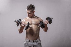 man exercise dumbbells bodybuilder