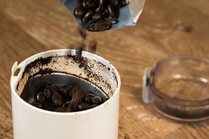 Coffee beans grinding in grinder