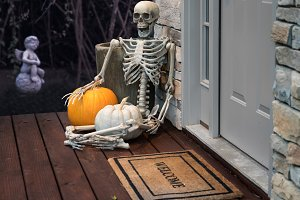Skeleton at front door for Halloween