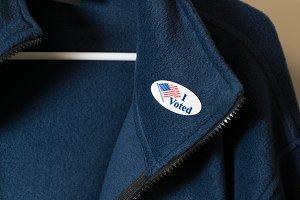 Voter hangs up his jacket after vote