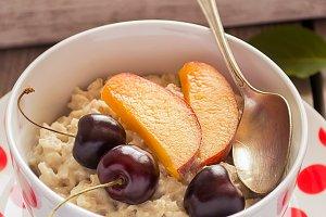 Healthy Breakfast. Oatmeal porridge with fruits.