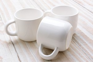 Three White Mugs Closeup