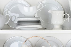White Plates in Cupboard and One Red