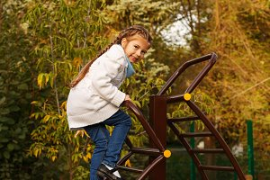 Girl climbs stairs on playground