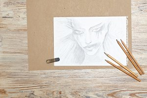 Sketches girl, pencils and eraser