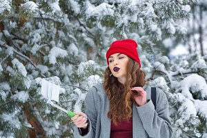 Hipster Girl makes selfie winter