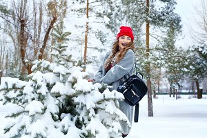 Hipster Girl and tree in winter