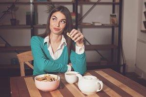 Woman is eating cookies