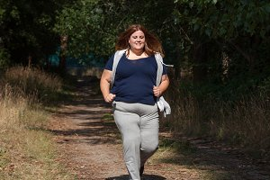 Overweight woman running