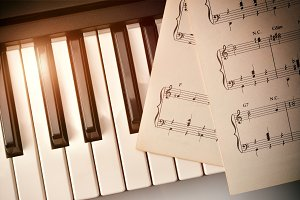 Piano keyboard and sheet music