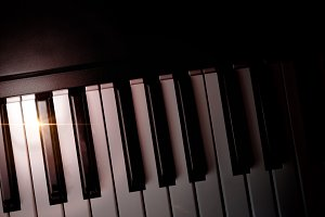 Piano keyboard in shade with shine
