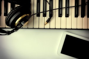 piano with headphones and tablet fx