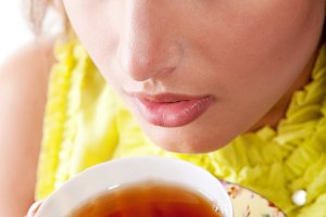 woman with fresh cup of black tea