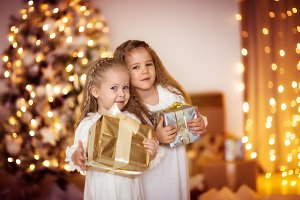 Girls kids with Christmas gifts