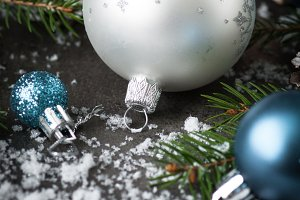 Christmas silver bauble pine cones fir tree and decorations.