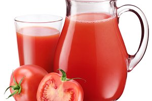 Full glass and carafe of tomato juice and. Isolated on a white.