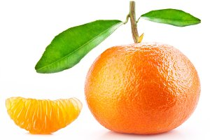 Tangerine with leaves and its slice on white background.