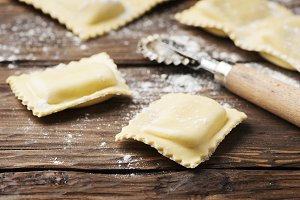 Uncooked ravioli on the wooden table