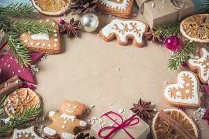 Background gifts, fir branches and Christmas cookies