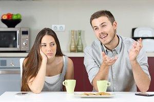 Bored wife hearing her husband