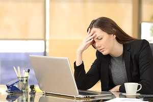 Businesswoman suffering migraines