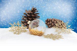 Christmas ornaments on snowy