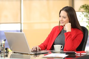Relaxed businesswoman working