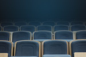 empty blue chairs in cinema