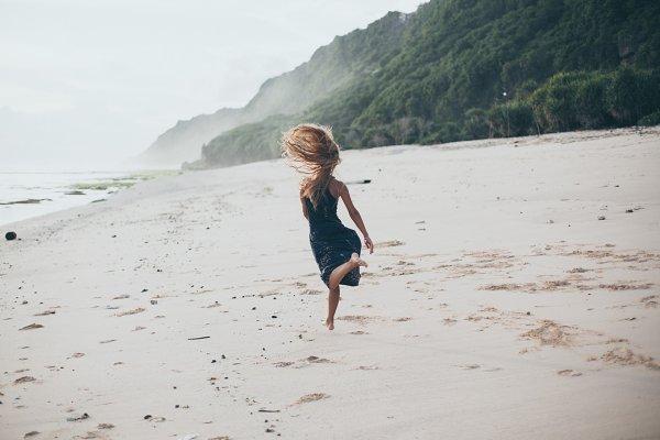 flying jump beach girl