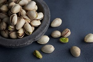 Green Pistachios in a Clay Bowl