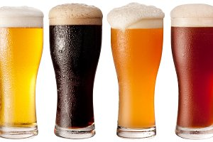 Glasses with four beers on a white background. The file contains a path to cut.