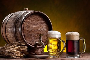 Beer glasses, old oak barrel