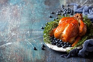Roasted whole chicken with rosemary and blueberries