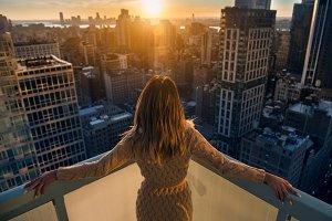 Rich woman enjoy city sunset
