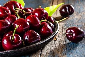 Fresh cherry on black plate
